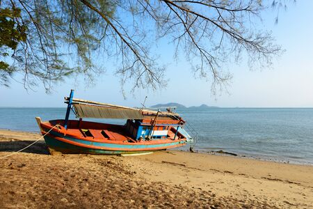 aground: Fishing boat aground on the beach