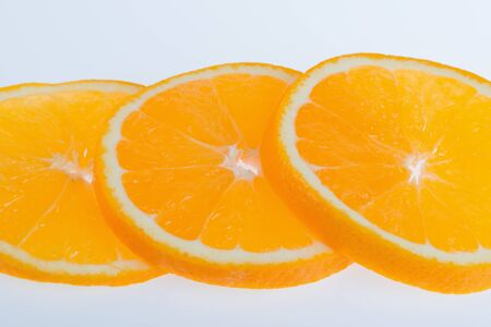cleave: Half of orange on a white background Stock Photo