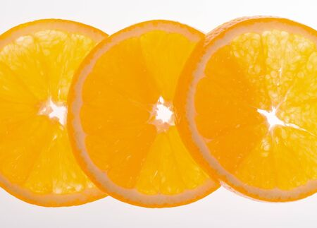 Half of orange on a white background Stock Photo