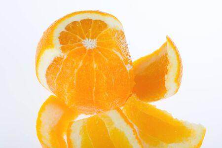 Peeled orange on a white background Stock Photo