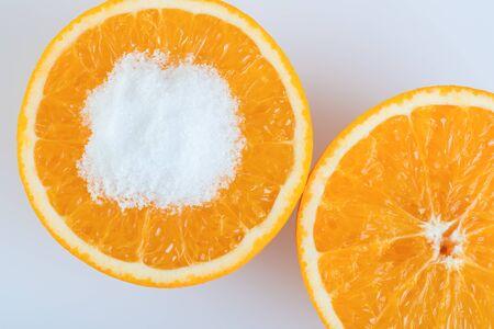 Orange fruit round slice with salt on white background