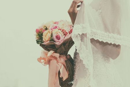 retro wedding bouquet with the flower in hands of the bride Stock Photo