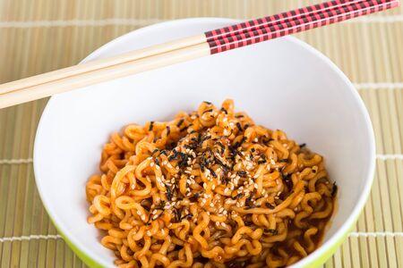 glutamate: Instant noodles on wood background