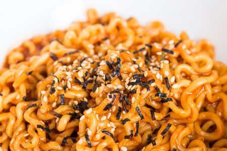 cooked instant noodle: Close-up instant noodles on white background