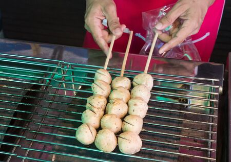 grill meatball on steel grating, a street food market Stock Photo