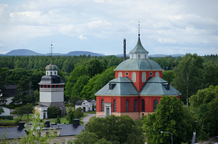 Soderhamn, Sweden - July 18 2017. View over the small town of Soderhamn between Stockholm and Sundsvall from its observation tower, Oscarsborg. The church Ulrika Eleonora. Editorial