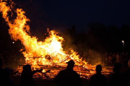 Stockholm, Sweden - April 30 2018. People celebrating walpurgis night, the coming of spring with a bonfire in the northern suburb of Stockholm, Akalla. Editorial