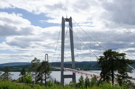 High coast, Sweden - 13 June 2018. The view from Hotel High coast of the bridge over the gulf of Bothnia on a slightly cloudy day Redactioneel