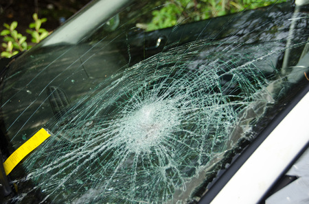 Cracked windshield on car with a fine