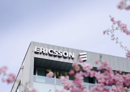Stockholm, Sweden - 4 may 2018. Spring at one of the office buildings to the multinational company Ericsson in Kista, Stockholm with japanese cherry blossom trees in the foreground