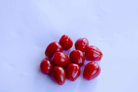 Red small cherry tomatoes in group on white background Stockfoto