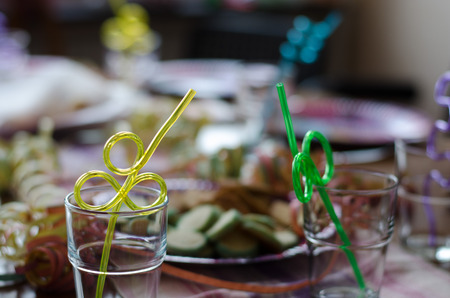 Celebration on the way, a kids birthday party with straws already placed in glasses Stockfoto