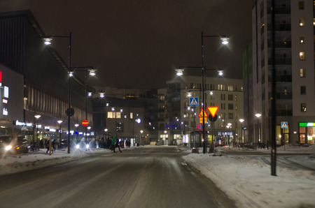 Urban scene in traffic during a evening in winter Redactioneel
