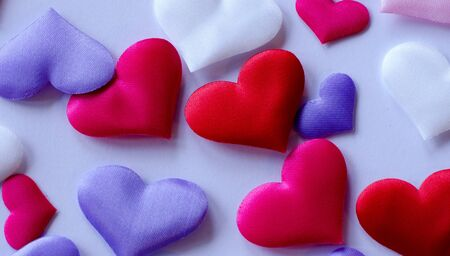Hearts in different colors and sizes on white background