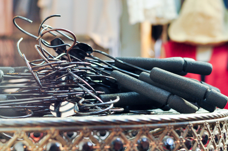 shirt hanger: Black Hanger On Old Table In Dress Store, Wholesale Shirt Stock Photo