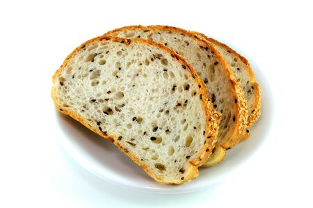 whole wheat toast: Sliced Mixed Sesame Bread Serving On White Plate On White Background