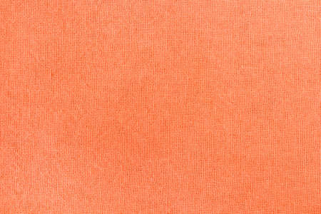 Orange fabric texture background, detail of silk or linen pattern. Archivio Fotografico