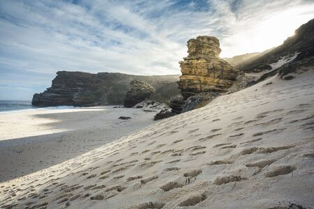 footprints in sand at dias beach next to cape point next to cape mountain. Shot in the Cape of Good Hope and Cape Point Nature Reserve, near Cape Town, South Africa. 版權商用圖片 - 131735696