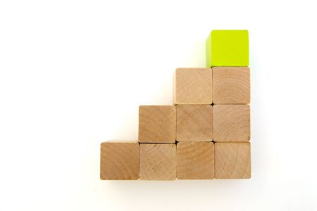 square wood blocks stacking as step stair. green block on top. Ladder career path concept for business growth success process, Copy space