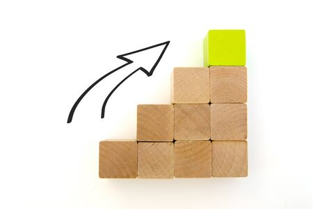 wood block stacking as step stair. Ladder career path concept for business growth success process, Copy space. Arrow goes upwards