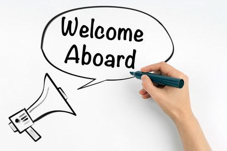 Welcome aboard. Megaphone and text on a white background Stock Photo