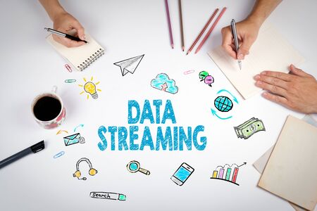 streaming: Data Streaming Concept. The meeting at the white office table.
