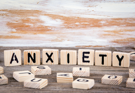 critical conditions: Anxiety from wooden letters on wooden background. Stock Photo