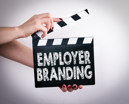 Employer Branding. Female hands holding movie clapper. Zdjęcie Seryjne