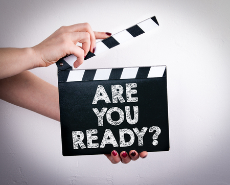 yoy: Are Yoy Ready. Female hands holding movie clapper. Stock Photo