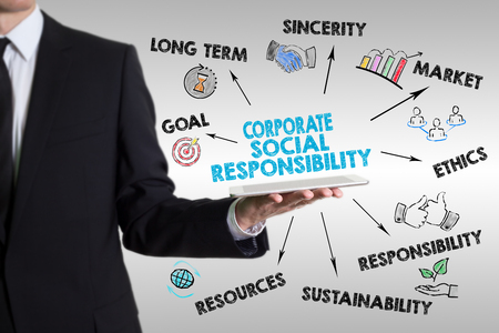 Corporate Social Responsibility Concept. Man holding a tablet computer.
