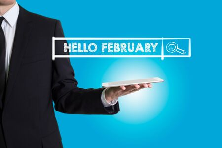 hi end: Hello February, young man holding a tablet computer. Stock Photo