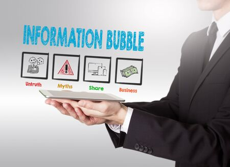 social history: Information Bubble concept, young man holding a tablet computer.
