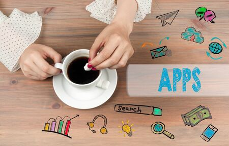 Apps concept. Coffee cup top view on wooden table background