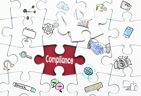 Compliance concept. White last piece of a Puzzle.