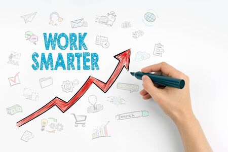 smarter: Hand with marker writing - Work Smarter, Business Concept. Stock Photo