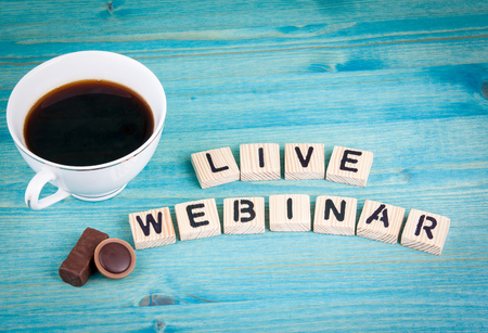 free education: live webinar. Coffee mug and wooden letters on wooden background. Stock Photo