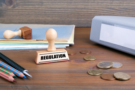 Regulation. Rubber Stamp on desk in the Office.
