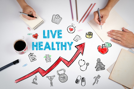 buen vivir: Live healthy concept. Healty lifestyle background. The meeting at the white office table. Foto de archivo