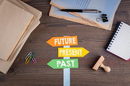 Future concept. Paper signpost on a wooden desk. Stock fotó