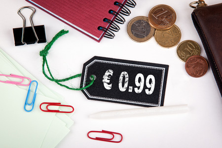 merchandize: 0.99 euro cent. Price tag with string on a white background. Stock Photo