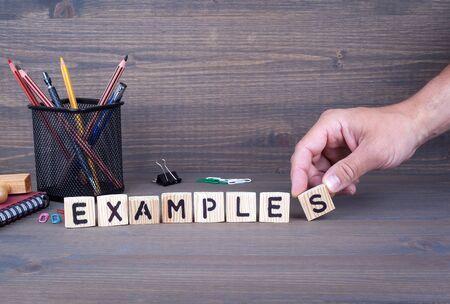 examples concept. Wooden letters on dark background Banco de Imagens