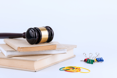 judicial proceeding: Wooden gavel and books in background. Law and justice concept. Stock Photo