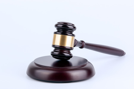 golden rule: Wooden gavel on a white background. Law and justice concept.