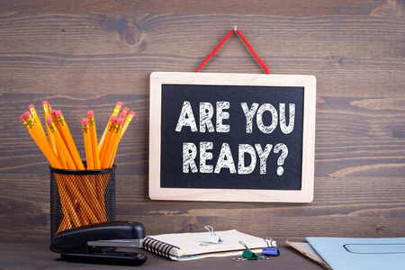 Are You Ready. Chalkboard on a wooden background. Standard-Bild