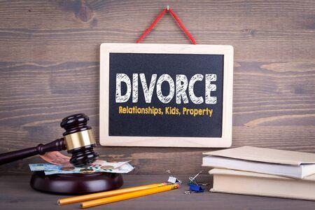 Divorce concept. Relationships Children Property. Chalkboard on a wooden background.