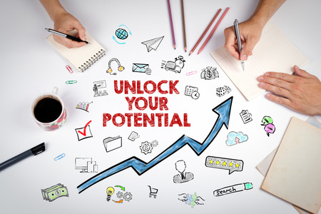 Unlock Your Potential concep. The meeting at the white office table.