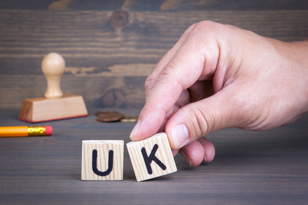 UK from wooden letters on wooden background.