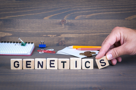 Genetics. Wooden letters on dark texture background Stock Photo