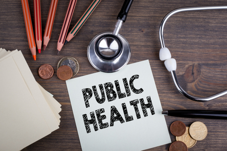 Public Health. Desk with stetascope, background for medical care. Фото со стока