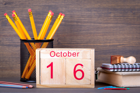 first year student: October 16. close-up wooden calendar. Time planning and business background.